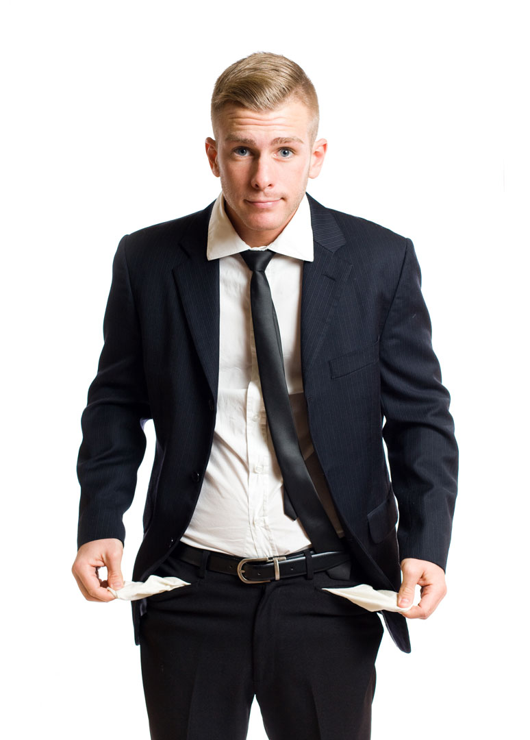 A gentleman in a black suit holding out empty pants pockets